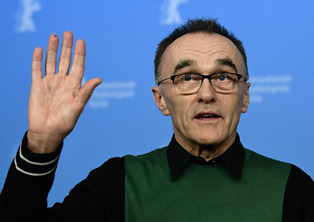 British director Danny Boyle poses for photographers during a photocall for the film T2 Trainspotting out of competition at the 67th Berlinale film festival in Berlin on February 10, 2017