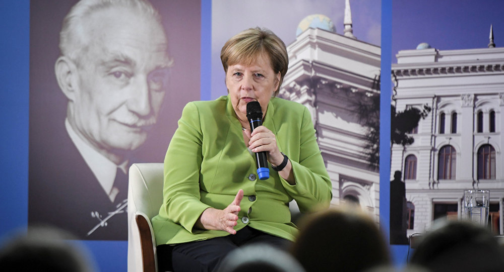 German Chancellor Angela Merkel gestures as she meets with students at the university in Tbilisi, Georgia August 24, 2018