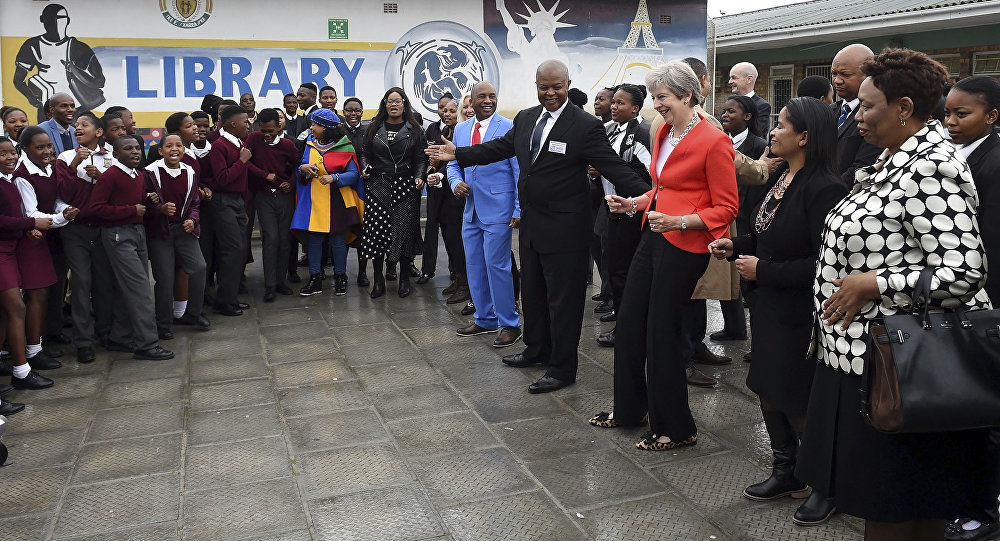 British Prime Minister Theresa May meets staff and pupils during a visit to the ID Mkhize High School in Gugulethu, Cape Town, South Africa, Tuesday, Aug. 28, 2018. Theresa May has started a three-nation visit to Africa where she is to meet South African President Cyril Ramaphosa
