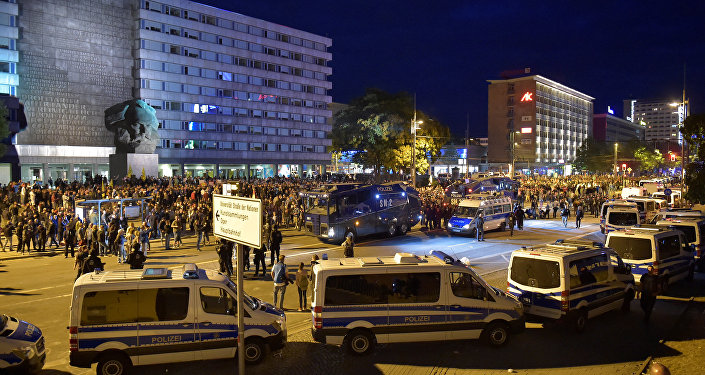 Police vehicles are seen as right-wing supporters protest after a German man was stabbed last weekend in Chemnitz, Germany, August 27, 2018