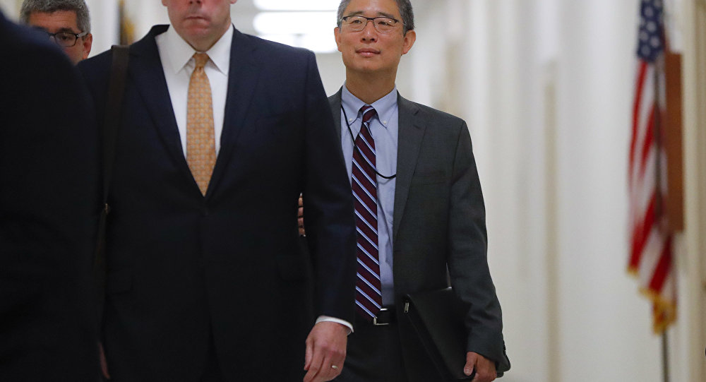Justice Department official, Bruce G. Ohr, center, arrives for a closed hearing of the House Judiciary and House Oversight committees on Capitol Hill in Washington, Tuesday, Aug. 28, 2018.