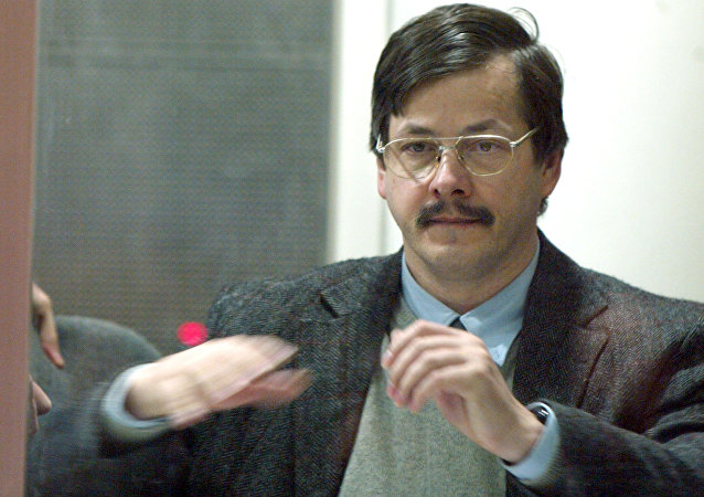 Marc Dutroux gestures while speaking from behind protective glass at the Palace of Justice in Arlon, Belgium, Monday May 3, 2004