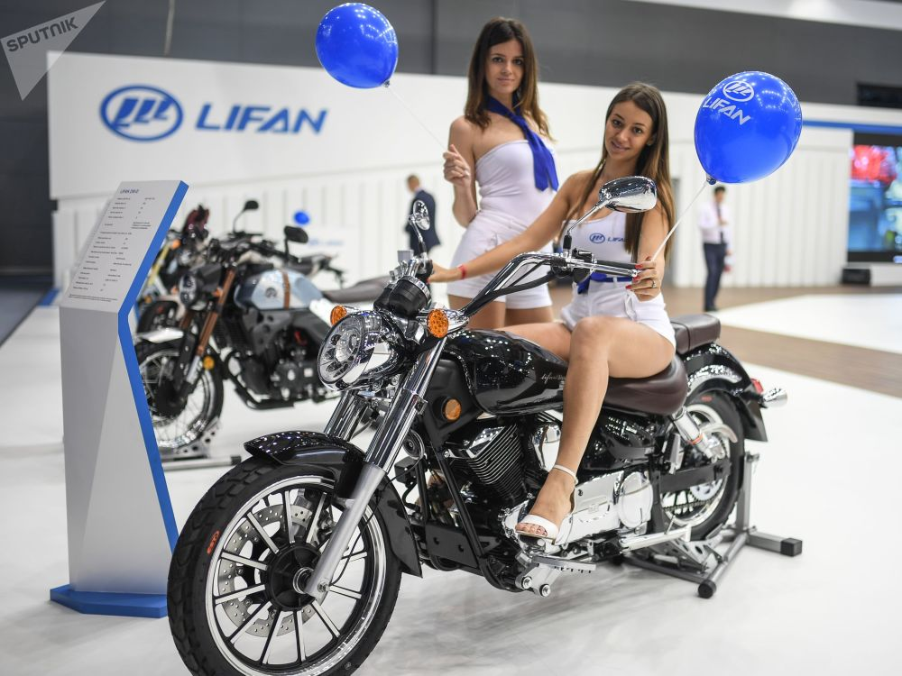 Getting Revved Up: Models Present Cars at Moscow International Automobile Salon