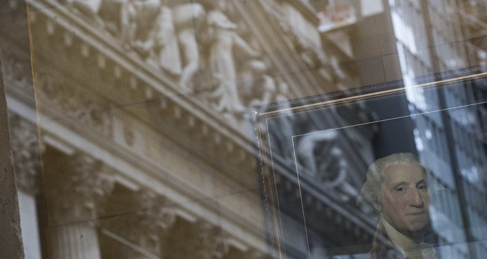 A portrait of former President George Washington is seen behind the reflection on the New York Stock Exchange