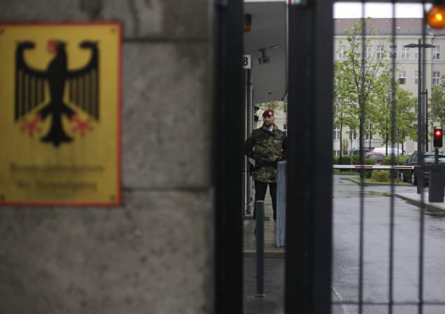 A guard stands at the entrance of the German Defense Ministry