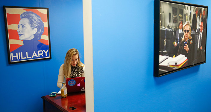 In this April 3, 2015, photo, intern Jessica Lis works at the Ready for Hillary super PAC offices in Arlington, Va. When Hillary Rodham Clinton announces her presidential campaign, as expected, more than a dozen people in a nondescript office building overlooking the Potomac River will blast out the news by email and social media to millions of her supporters, urging them to sign onto her campaign