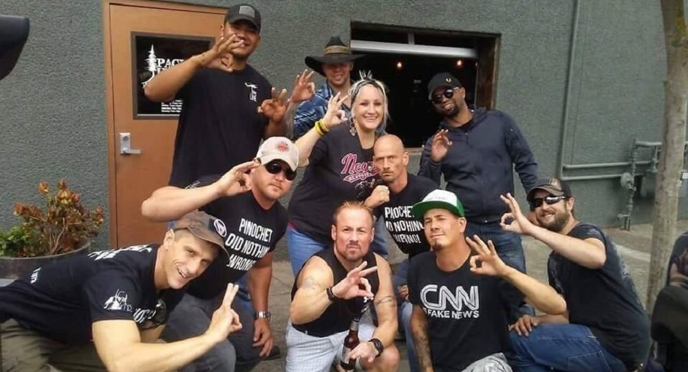 Patriot Prayer + Proud Boys in Vancouver night b4 Aug 4 Portland rally many fear will end in violence. Tusitala Tiny Toese and others make an apparent White Power hand gesture. T-shirts read, Pinochet Did Nothing Wrong.