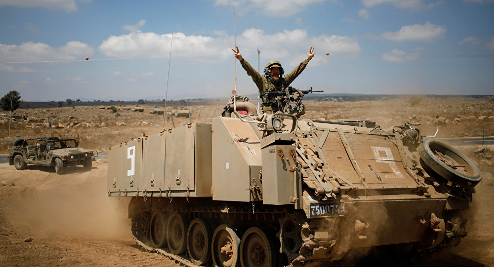 An Israeli soldier rides an armoured vehicle during a army drill after the visit of Israeli Defence Minister Avigdor Lieberman in the Israeli-occupied Golan Heights, Israel August 7, 2018