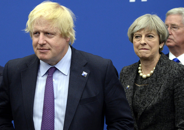 In this Thursday, May 25, 2017 file photo British Foreign Secretary Boris Johnson, left, and Britain's Prime Minister Theresa May arrive for a meeting during the NATO summit of heads of state and government, at the NATO headquarters, in Brussels. British ex-Foreign Secretary Boris Johnson has slammed Prime Minister Theresa May's Brexit policy, a move likely to fuel speculation that he is seeking to oust her. Johnson wrote in the Daily Telegraph on Monday Sept. 3, 2018 that May's so-called Chequers plan for continued ties with the European Union after Brexit will leave Britain in a weakened position