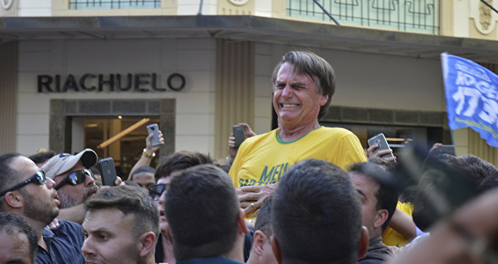 Presidential candidate Jair Bolsonaro grimaces right after being stabbed in the stomach during a campaign rally in Juiz de Fora Brazil Thursday Sept. 6 2018