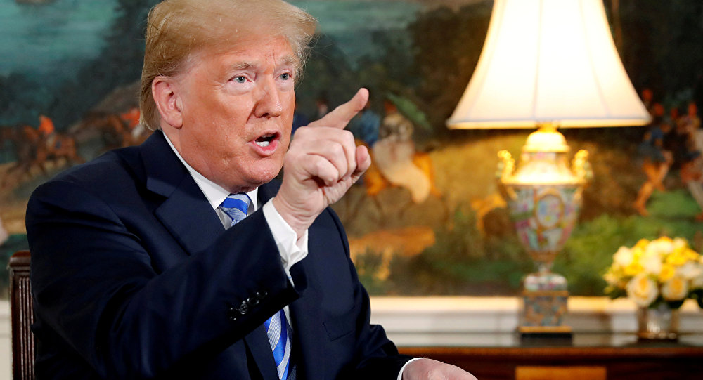 US President Donald Trump speaks to reporters in the Diplomatic Room at the White House in Washington, DC
