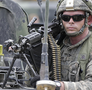 A US soldier takes part in an exercise called Saber Junction at the military area in Hohenfels near Regensburg, southern Germany