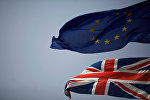 The Union Jack (bottom) and the European Union flag are seen flying, at the border of Gibraltar with Spain, in the British overseas territory of Gibraltar, historically claimed by Spain, June 27, 2016, after Britain voted to leave the European Union in the EU Brexit referendum