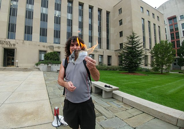 "DC Indymedia reporter Luke Kuhn was served a subpoena September 5 informing him that he was ""commanded"" to testify before a federal grand jury. Kuhn burned a copy of the subpoena outside of the courthouse as he refused to testify."