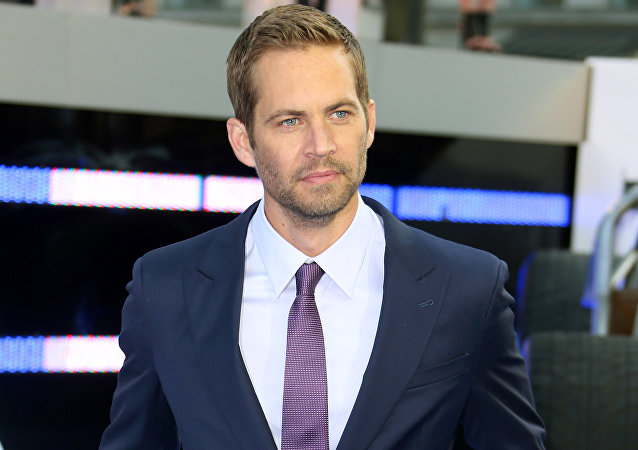 "In this May 7, 2013 file photo, actor Paul Walker arrives for the World Premiere of Fast & Furious 6, in central London. Wiz Khalifa and Charlie Puth's song, ""See You Again,"" a tribute to Walker, hit No.1 on Billboard Hot 100's chart this week. It is featured on the ""Furious 7"" soundtrack, which debuted at No.1 on Billboard's 200 albums chart this week"