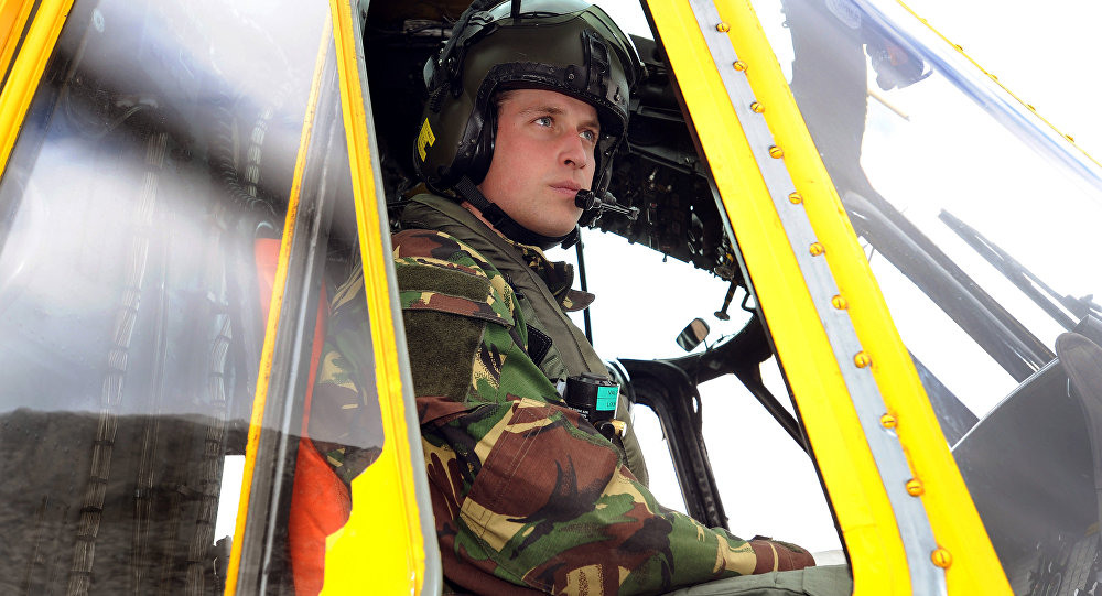 Britain's Prince William is pictured at the controls of a Sea King helicopter during a training exercise at Holyhead Mountain, having flown from RAF Valley in Anglesey, north Wales, on March 31, 2011.