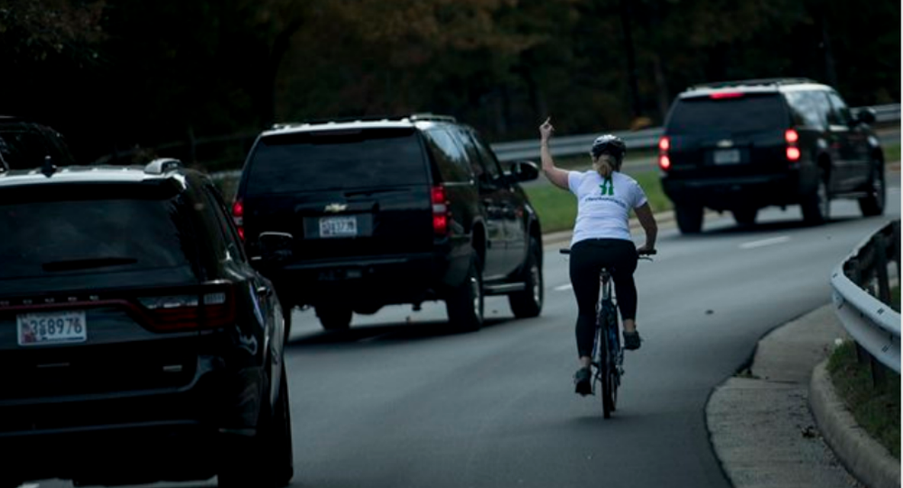 Juli Briskman flipping off Trump Motorcade