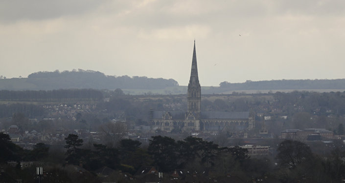 In this Tuesday, March 13, 2018 file photo the combined tower and spire of Salisbury Cathedral stand surrounded by the medieval city where former Russian double agent Sergei Skripal and his daughter were found critically ill following exposure to the Russian-developed nerve agent Novichok in Salisbury, England