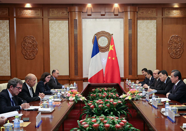 China's Foreign Minister Wang Yi meets with France's Foreign Affairs Minister Jean-Yves Le Drian at Diaoyutai State Guesthouse in Beijing, China September 13, 2018