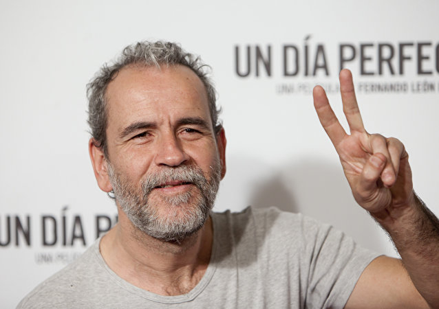 Spanish actor Willy Toledo poses for photographers during the premiere of the film: 'A Perfect Day' in Madrid, Spain. Tuesday, August 25, 2015