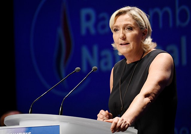 Leader of France's Rassemblement National (RN) far-right political party Marine Le Pen gestures as she delivers a speech at a meeting in Fréjus, southern France on September 16, 2018.
