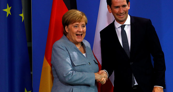 German Chancellor Angela Merkel and Austrian Chancellor Sebastian Kurz shake hands after giving a statment to the media in the chancellery in Berlin, Germany, September 16, 2018.