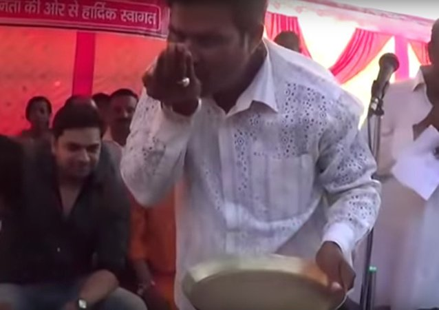 BJP worker washes the feet of Godda MP Nishikant Dubey, drinks the dirty water