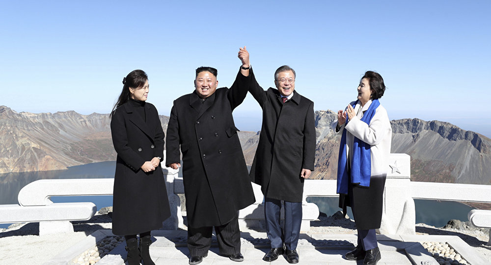 South Korean President Moon Jae-in, second from right, and his wife Kim Jung-sook, right, stand with North Korean leader Kim Jong Un, second from left, and his wife Ri Sol Ju on the Mount Paektu in North Korea, Thursday, Sept. 20, 2018