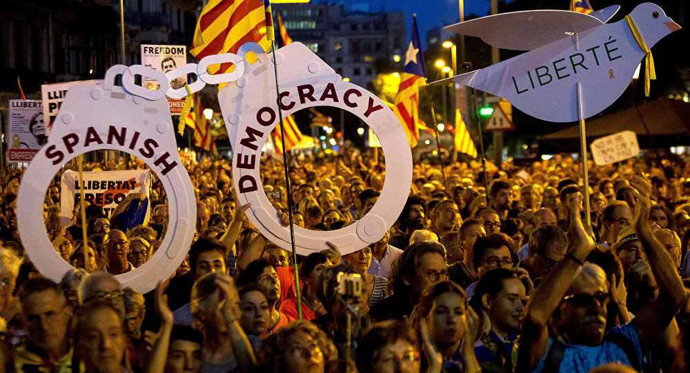 Pro-independence demonstrators gather to mark one year of the Spanish police raid and protest which lead to the imprisonment of the leaders of Catalonia's main pro-independence movements in Barcelona, Spain, September 20, 2018.