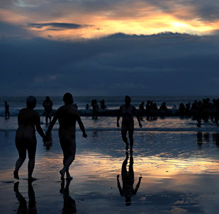 Participants in the annual North East Skinny Dip run into the sea at Druridge Bay, Britain, September 23, 2018