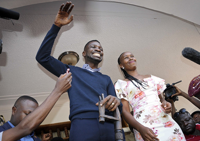 Bobi Wine waves to supporters after arriving back in Uganda in September 2018 after receiving medical treatment in the US