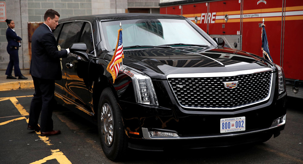 A U.S. Secret Service agent cleans U.S. President Donald Trump's brand new version of the General Motors built Cadillac presidential limousine known as The Beast before its debut drive with the president aboard in New York City, New York, U.S., September 23, 2018