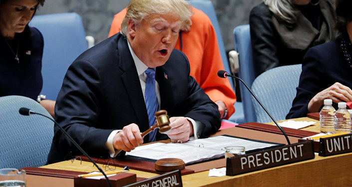 U.S. President Donald Trump, representing the United States as current President of the United Nations Security Council, bangs the gavel to open the U.N. Security Council meeting at the 73rd session of the United Nations General Assembly at U.N. headquarters in New York, U.S., September 26, 2018