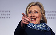Hillary Clinton points to the audience as she is introduced at Harvard University in Cambridge, Mass., Friday, May 25, 2018. Harvard University's Radcliffe Institute honored Clinton with the 2018 Radcliffe Medal