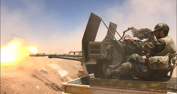 Syrian soldiers are shooting near the border with Iraq in Homs province
