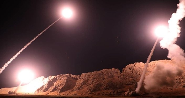 In this photo released on Monday, Oct. 1, 2018, by the Iranian Revolutionary Guard, missiles are fired from city of Kermanshah in western Iran targeting the Islamic State group in Syria.