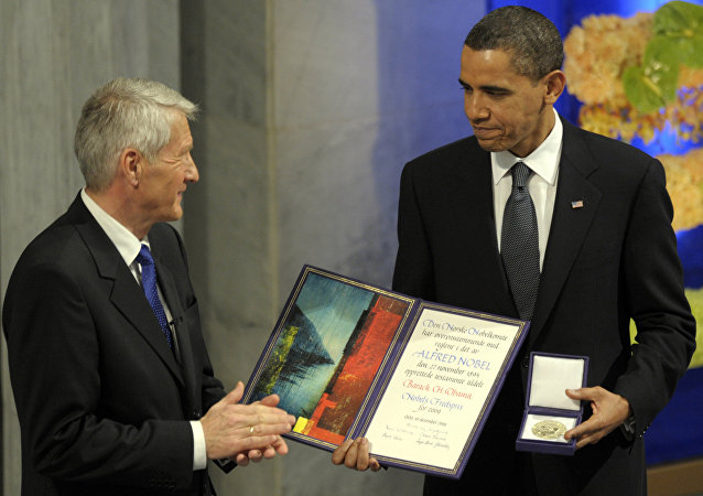 US President Barack Obama, right is applauded by Nobel Committee Chairman Thorbjorn Jagland after receiving the Nobel Peace Prize during a ceremony in the Main Hall of Oslo City Hall in Oslo, Norway. (File)