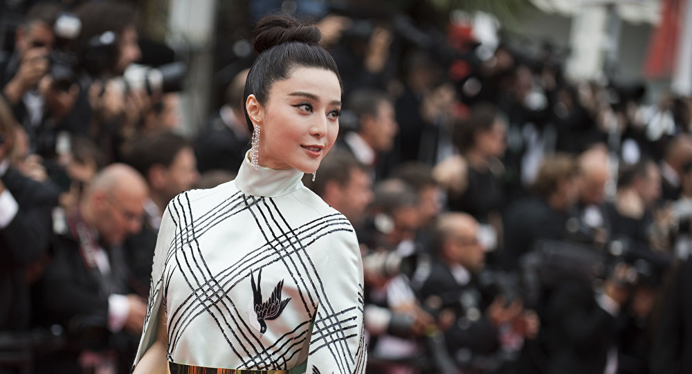 Fan Bingbing poses for photographers upon arrival at the screening of the film L'Amant Double at the 70th international film festival, Cannes, southern France, Friday, May 26, 2017.