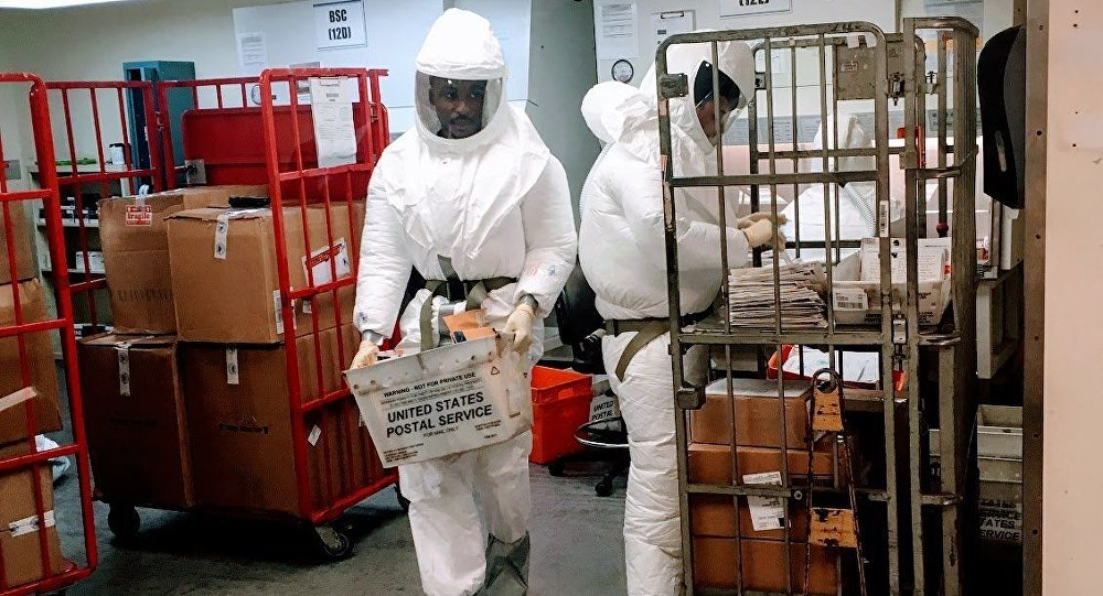 US Defense Department personnel, wearing protective suits, screen mail as it arrives at a US government facility near the Pentagon in Washington, DC on October 2, 2018