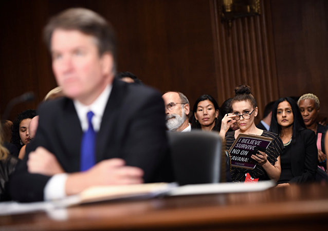 Actress Alyssa Milano listens to Supreme Court nominee Brett Kavanaugh as he testifies before the Senate Judiciary Committee on Capitol Hill in Washington, DC, U.S., September 27, 2018