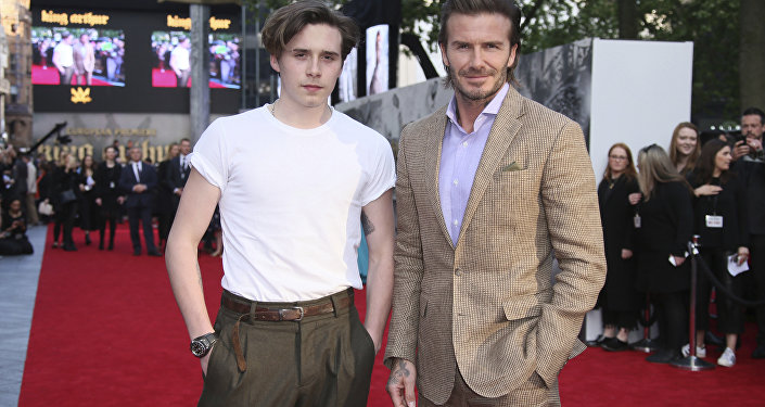 Actor David Beckham, right, poses with his son Brooklyn Beckham for photographers upon arrival at the premiere of the film 'King Arthur The Legend Of The Sword'', in London, Wednesday, May 10, 2017