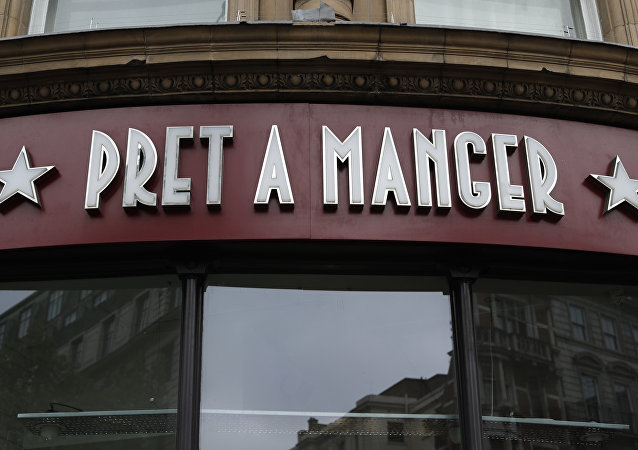 A view of a window and logo of a Pret A Manger, in London, Tuesday, May 29, 2018. The British Sandwich shop chain is being taken over by German controlled investment group JAB Holding Company in a deal worth more that 1.5 billion pounds sterling.