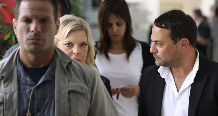 Sara Netanyahu, wife of Israeli Prime Minister Benjamin Netanyahu, second left, arrives to a court hearing in a fraud trial against her, at the Magistrate court in Jerusalem, Sunday, Oct. 7, 2018