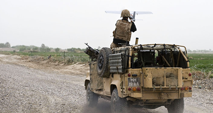 A soldier of Bravo Company, 1 Rifles launches a Desert Hawk UAV (Unmanned Aerial Vehicle) from a WMIK Landrover during an operation near Garmsir, Afghanistan.