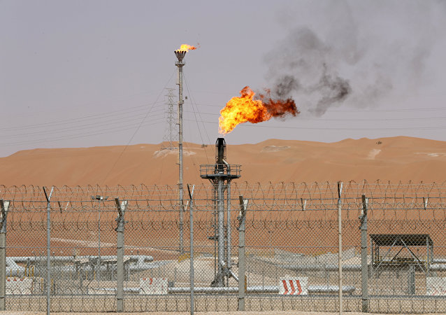 Flames are seen at the production facility of Saudi Aramco's Shaybah oilfield in the Empty Quarter, Saudi Arabia May 22, 2018. Picture taken May 22, 2018
