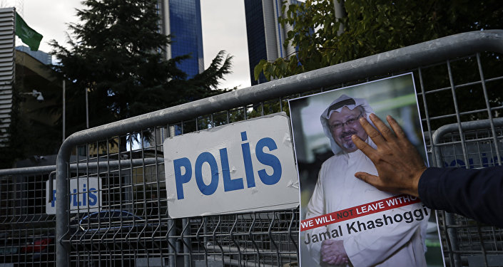 A poster of missing Saudi writer Jamal Khashoggi, on a barrier that blocks the road leading to the Saudi Arabia consulate in Istanbul.
