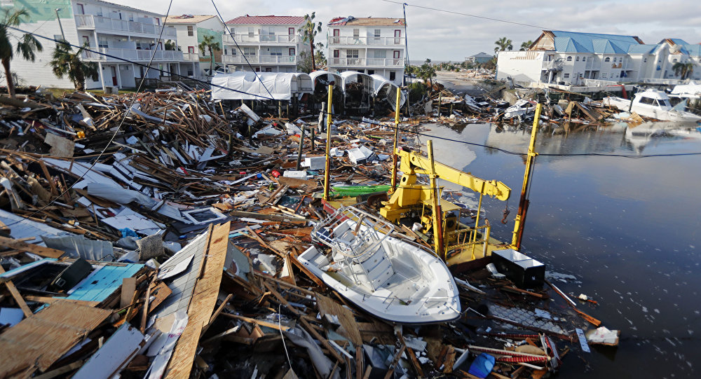 A boat sits amidst debris in the aftermath of Hurricane Michael in Mexico Beach, Fla., Thursday, Oct. 11, 2018.