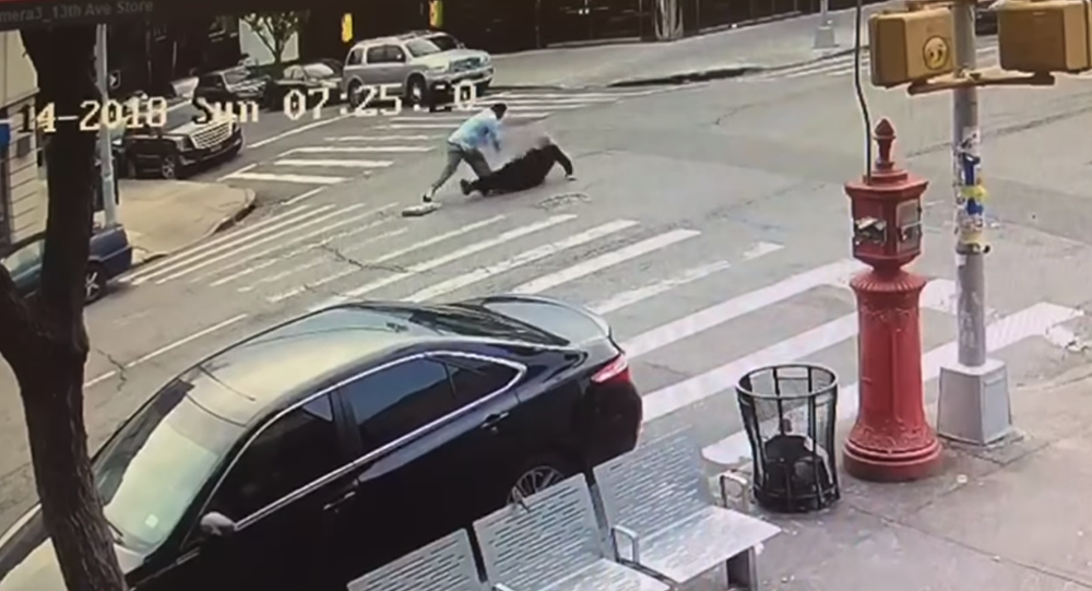 New York City taxi driver caught on surveillance footage chasing after Jewish man before repeatedly punching him in the head.