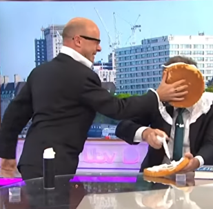 Piers Morgan gets pied by comedian Harry Hill over recent remarks made about actor Daniel Craig