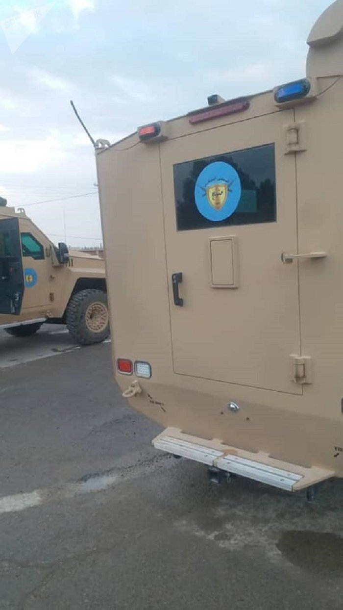 Armored vehicles in Syria's Manbij.